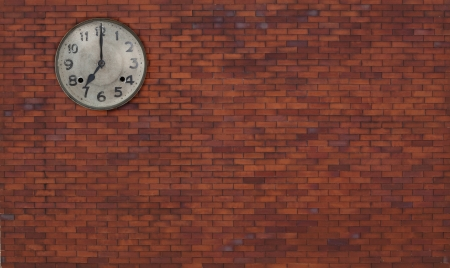 seven o clock time on red brick wall photo