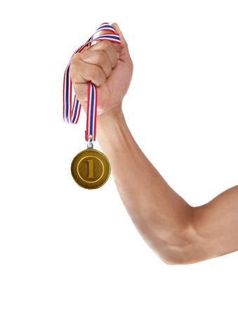 hand and gold mmedal isolated on white background photo