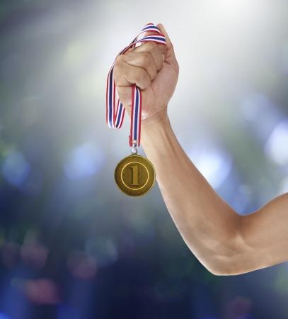 ganar: mano y oro mmedal