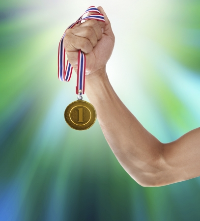 gold medal: hand and gold medalfor multipurpose Stock Photo