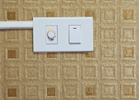 switch of electric appliance on wall photo