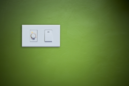 switch on electric appliance on green wall for multipurpose photo