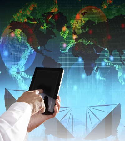 out door: hand and computer tablet with modern office building background use for monern business and city life style
