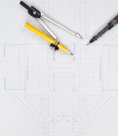 compass and writing pen on architect plan for construction industries theme photo