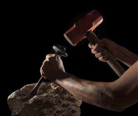rock hand: abstract of hand hammer and hard rock isolated on black  use as fighting to success  Stock Photo