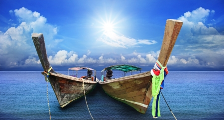 long tailed boat: andaman long tailed boat southern of thailand  floating on clear sea water with sun shine on blue sky