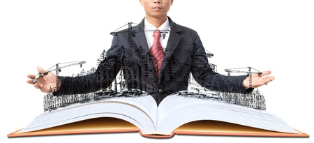 land management: man and open book with building construction on white ude for multipurpose about construction and architecture Stock Photo
