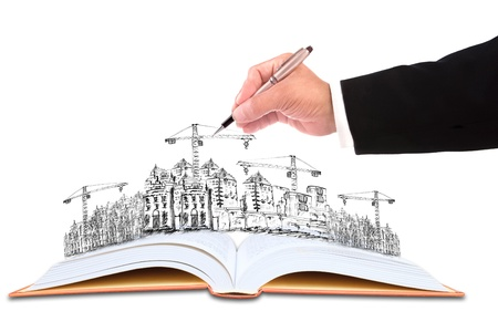 hand of businessman writing on sketching of  building construction for construction business theme photo