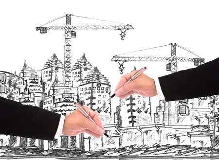hand of businessman writing on skitching of building construction  use for construction business theme photo