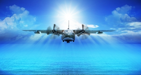 space weather tire: c123 military plane landing with blue sky sun shine background
