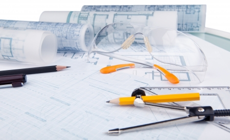 drafting table: safety glasses and writing equipment of architect on working table Stock Photo