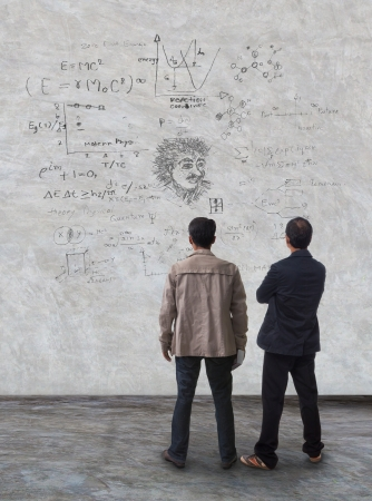 two man standing and watching formula on wall use for multipurpose photo