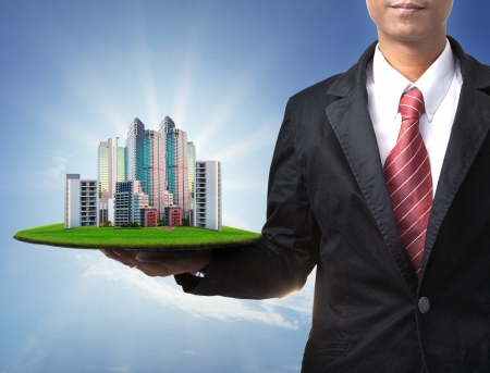property management: business man and real estate in hand