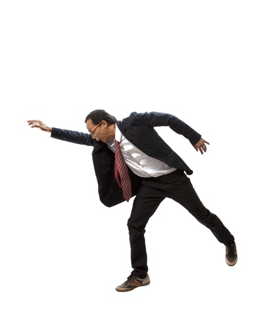 businessman jumping: portrait of asian man reaching hand to something isolated white Stock Photo