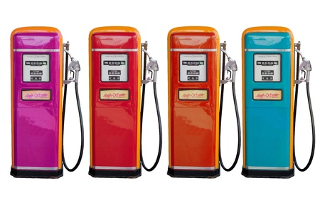 gas distribution: several color of old classic oil distributor in gasoline station service  isolated white use for retro and vintage style