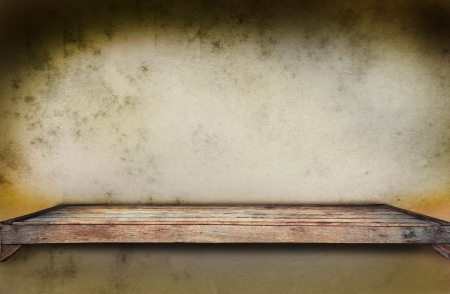old wood shelf on grungy wall use for multipurpose background