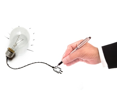 hand of business man writing wire of light bulb  use for multipurpose  photo