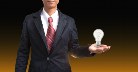 man en lamp in de hand voor slimme mensen