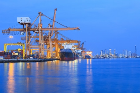 ship yard with heavy crane in beautiful twilight of day use for import export industry and international trading photo