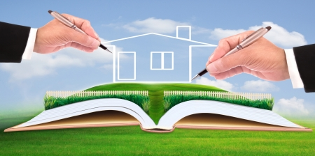 property management: business man writing new house on beautiful green field use for multipurpose