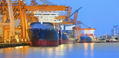 loading bay: panorama scene of ship yard with heavy crane in beautiful twilight  use for import export industry and international world trading  Stock Photo