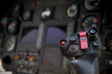 military press: helicopter control stick in side pilot cockpit