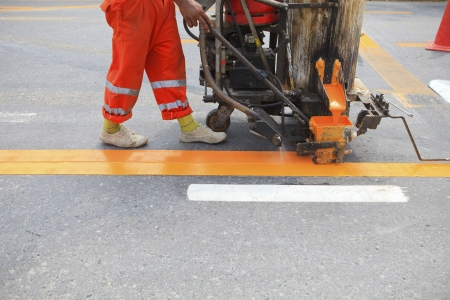 infra construction: machine and worker at road construction use for road and traffic sign painting