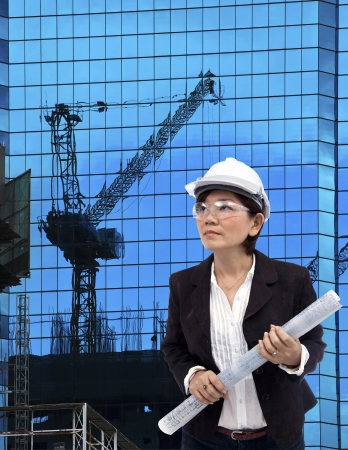 construction work: female architect and building construction project site