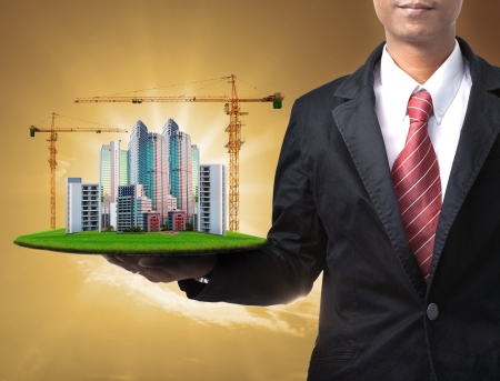 construction management: business man and building construction
