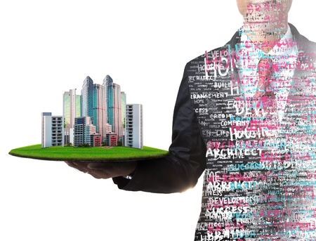 land management: business man and real estate in hand