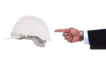 safety helmet: mano apuntando al blanco casco de seguridad