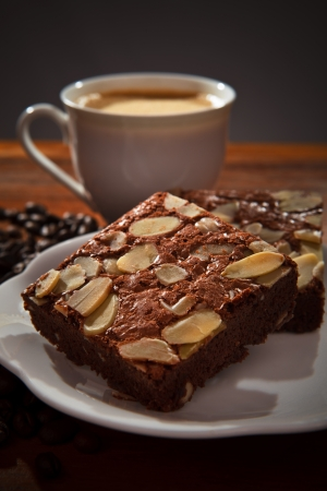 brownie cake and hot coffee on wood table photo