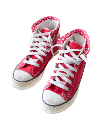 old red  sneaker shoes isolated white background photo
