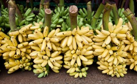 mas: group of little fresh banana in market for sale