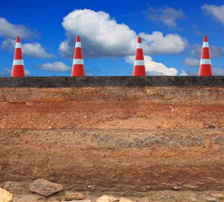 soil texture: cutting surface of asphalt road inner structure scouring by water flood attack indicated layer of road structure and road making process