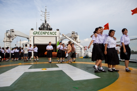 BANGKOK THAILAND - Jun 27 Unidentified young student  walking on the esperanza ship of greenpeace  international environmental organization at Bangkok port on June 27, 2013 in Bangkok, Thailand