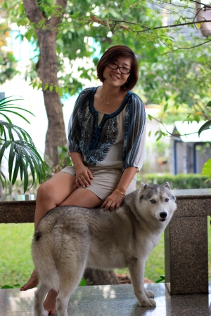 Woman and siberian husky dog with relaxing emotion photo