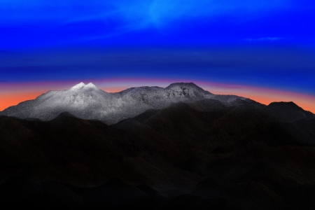 land scape: land scape of snow mountain hill with beautiful dramatic colorful sky before morning dawn light use for nature background and backdrop Stock Photo