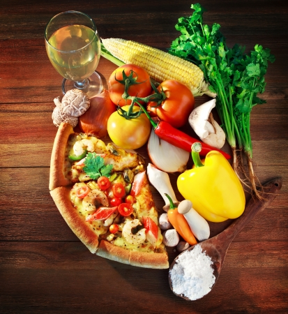 sea food: mixed contain and vegatable with  pieces of sea food pizza on wood table  Stock Photo