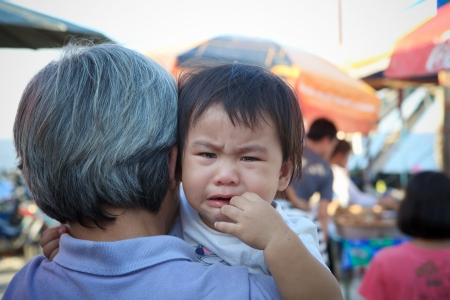 two years: close up crying face of two years old child