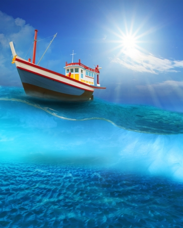 fishery boat floating on blue sea wave with sun shining on blue sky photo