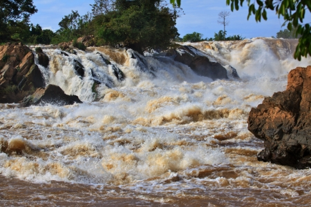 don: conprapeng water fall  or mekong river in champasak southern of laos one of the biggest and beautiful waterfall in asia and world