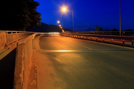 infra construction: curve of high way road in dusky sky  Stock Photo