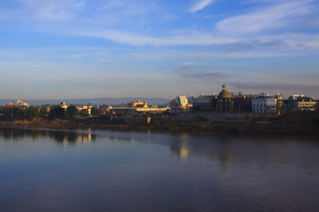 distric: views of chamapasak city beside mekong river in morning light important province distric of southern laos  Stock Photo