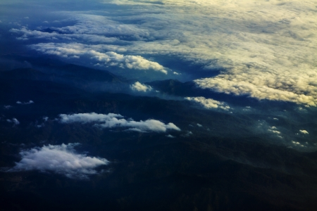 cloud scape: mountain and cloud scape from above plane windows