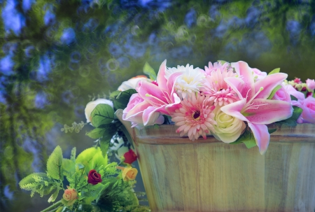 beautiful flowers bouquet arranged in wood bucket with  copy space and blur background use as multipurpose backdrop and beautiful nature scene photo