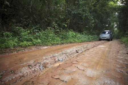 mud slide: car in nature track off road in rain forest wilderness Stock Photo