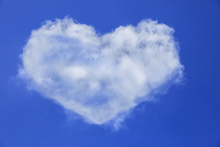 heart shape of white cloud on blue sky use for multipurpose natural  background or backdrop photo