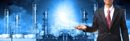 business man and refinery industry plant use for heavy industry and petrochemical industry theme photo