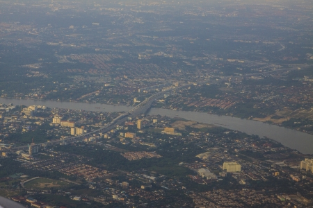 top view from plane window focus to bts sky train construction cross chaopraya river Stock Photo - 24730292